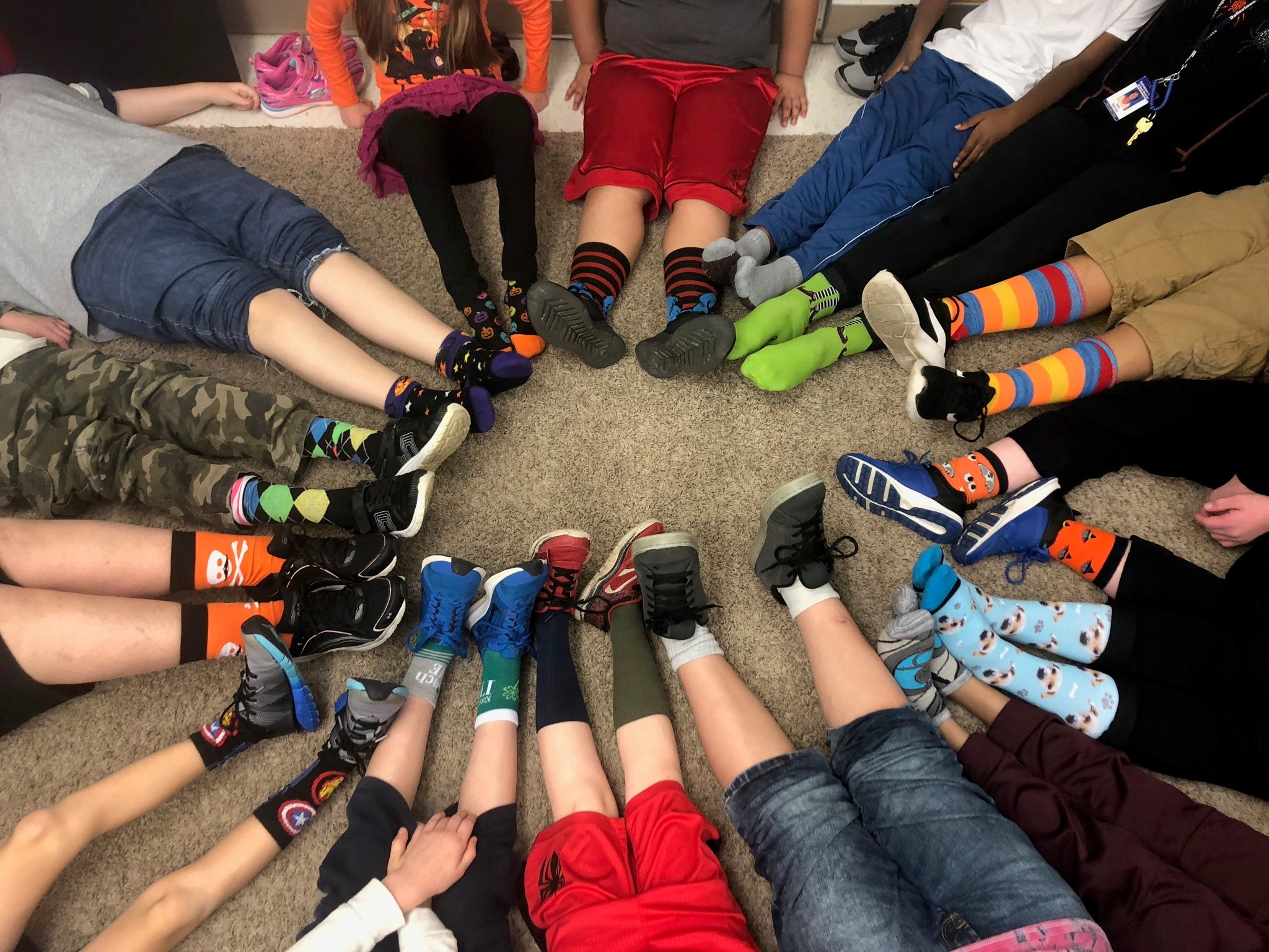 Students celebrate positivity with their feet in a circle.